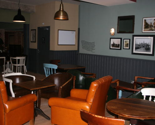 Advanced Electrical C#1 Stratford vintage lighting, reclaimed timber flooring and colourful walls.
